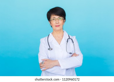 Smiling medical doctor woman with stethoscope. Over blue background