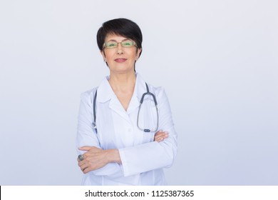 Smiling medical doctor woman with stethoscope. Over white background