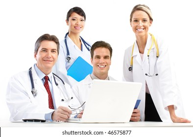 Smiling medical doctors with stethoscopes and computer. Isolated over white background