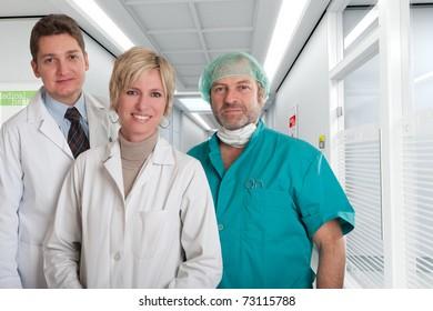Smiling medical team in a hospital interior