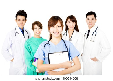 smiling Medical team standing together isolated on white
