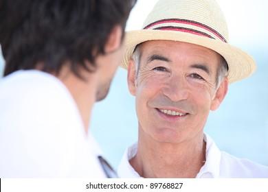 Smiling men in the sunshine