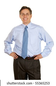 Smiling middle age businessman with hands on hips