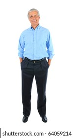 Smiling middle aged businessman standing with his hands in pockets. Business man is in full  length over a white background.