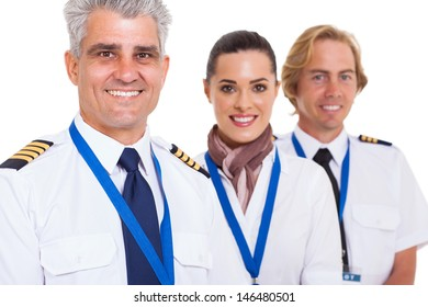 smiling middle aged pilot and crew isolated on white