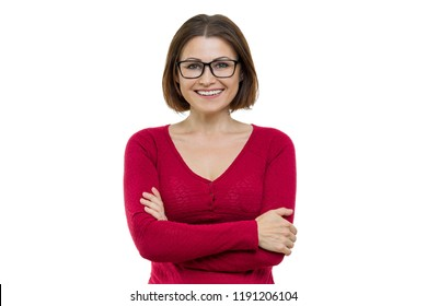 Smiling middle aged woman with folded arms on white background, isolated.