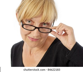 smiling middle-age woman touching her glasses