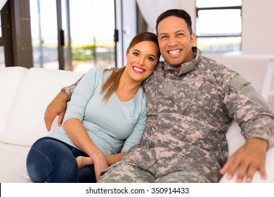 smiling military couple relaxing on the couch