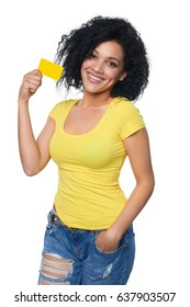 Smiling mixed race african ethnicity woman holding credit card standing relaxed isolated on white background