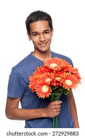 Smiling mixed race man holding bunch of flowers. Studio shot on white background.