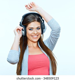 Smiling model. young woman with headphones listen music.  isolated background.