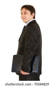 Smiling modern businessman holding laptops in hand isolated on white