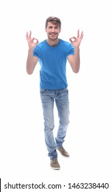 smiling modern guy showing OK gesture. isolated on white