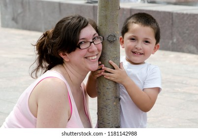 smiling mom and son pose for a sweet portrait