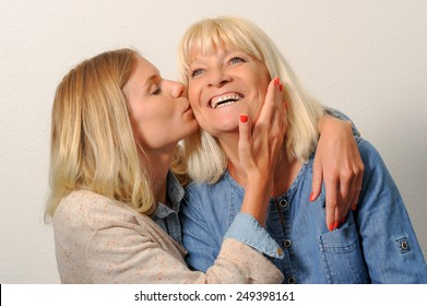 Smiling mother and Adult daughter
