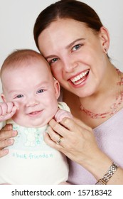 Smiling Mother and Baby on a white background