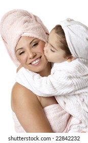 Smiling mother and daughter at bathtime