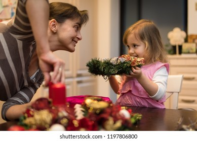 Smiling mother and daughter doing christmas preparation