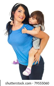 Smiling mother giving piggy back to her daughter isolate don white background