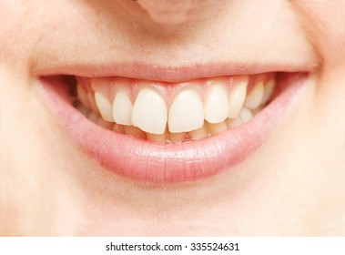 Smiling mouth of a young woman with white teeth