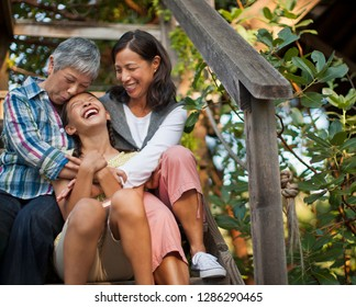 Smiling multi generational family sitting together.