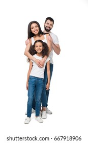 smiling multiethnic family standing and looking at camera together isolated on white