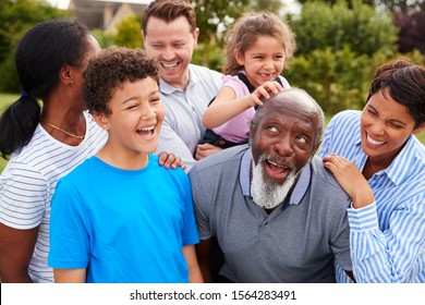 Smiling Multi-Generation Mixed Race Family Having Fun In Garden At Home