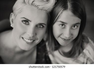 Smiling mum and daughter