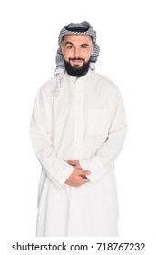 smiling muslim man looking at camera isolated on white