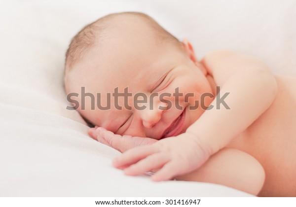 Smiling newborn baby boy