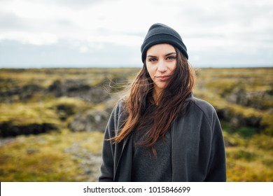 Smiling nordic woman enjoying in the mountain landscape.Harmony with nature.Spending free time in natural environment.Woman enjoying mountains landscape