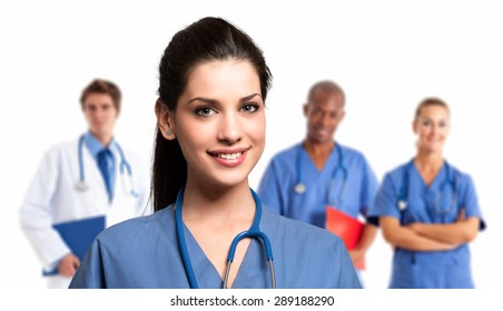 Smiling nurse in front of her medical team