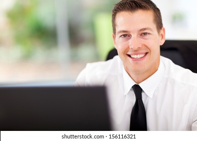smiling office worker looking at the camera
