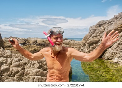 Smiling old man talks after snorkelling. Shot on the Otter trail in the Tsitsikamma National Park, Garden Route area, Western Cape, South Africa.