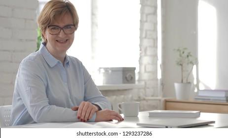 Smiling Old Woman Looking at Camera