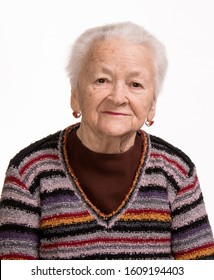 Smiling old woman posing in studio on a white background