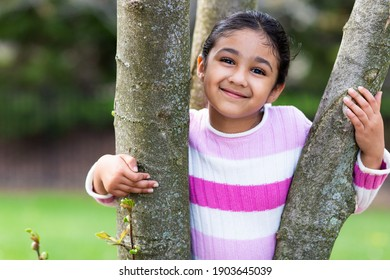Smiling Outdoor Portrait of a Little Girl in Spring