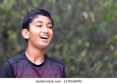 Smiling Outdoor Portrait of a Young Boy