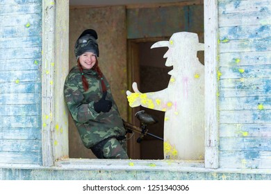 Smiling paintball player and plywood cowboy show thumb up