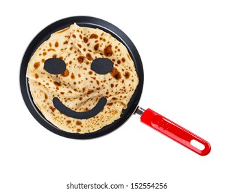 Smiling pancake on a griddle