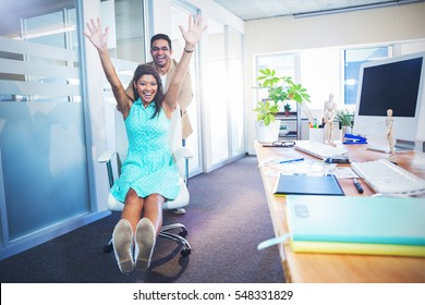 Smiling partners having fun in the office