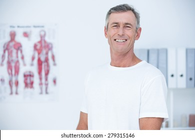 Smiling patient looking at camera in medical office