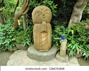 Smiling peaceful Jizo Statue at Hase Temple (Hase Dera) in Kanagawa Prefecture, Japan.