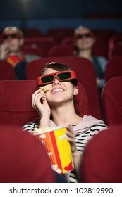 Smiling people a the 3D cinema