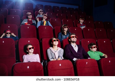 Smiling people in 3D movie theater