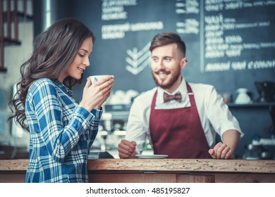 Smiling people in coffee shop