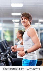 Smiling people in fitness club