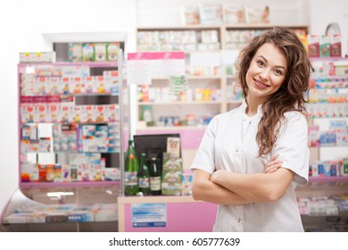Smiling pharmacist at her work place looking in camera