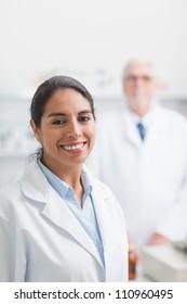 Smiling pharmacist in hospital