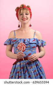 Smiling pin up girl with lollipop